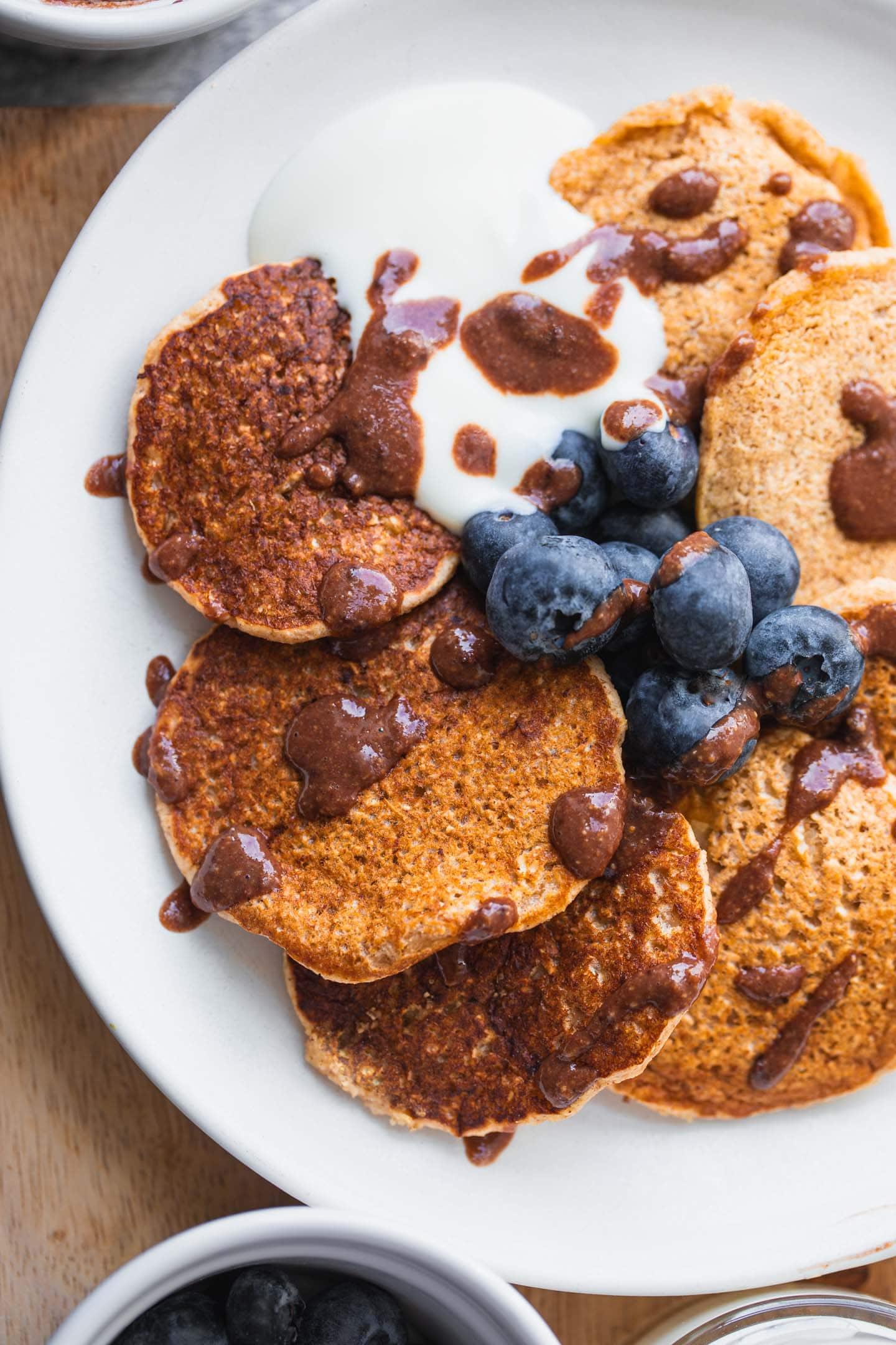 Closeup of vegan pancakes with chocolate sauce