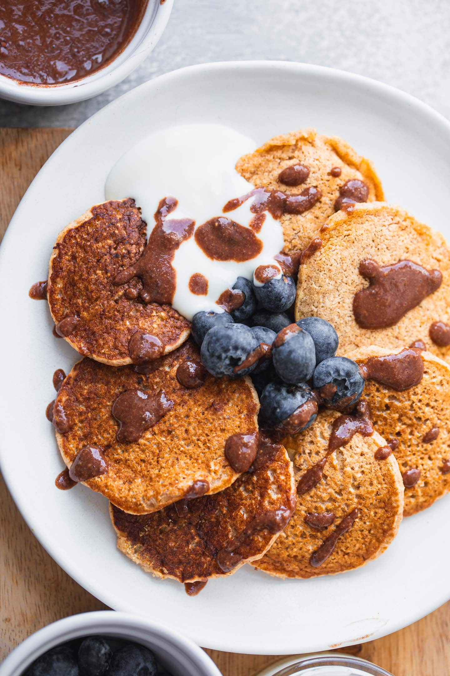 Vegan cinnamon pancakes with chocolate sauce