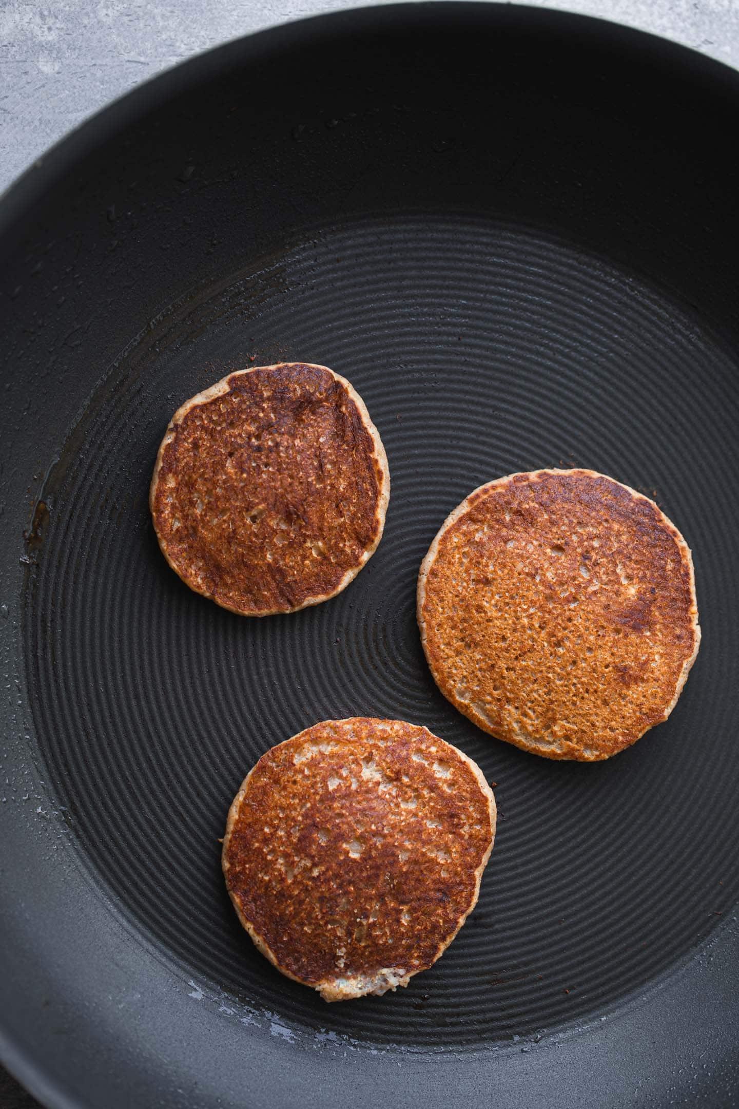 Vegan pancakes in a large pan