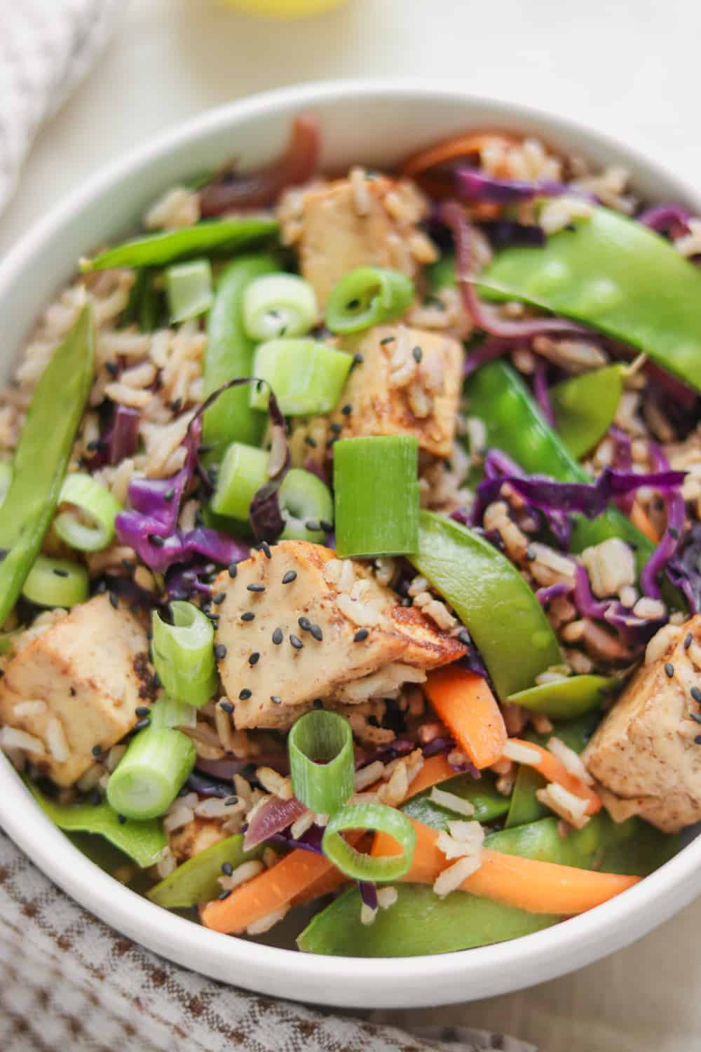 Vegan stir-fry bowl with tofu, vegetables and rice