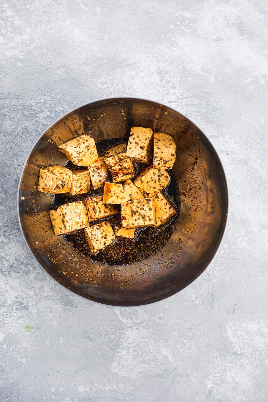 Tofu marinading in a bowl