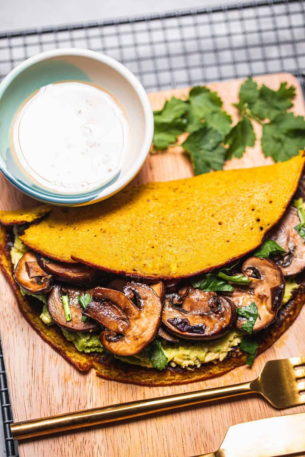 Chickpea omelette with mushrooms and avocado