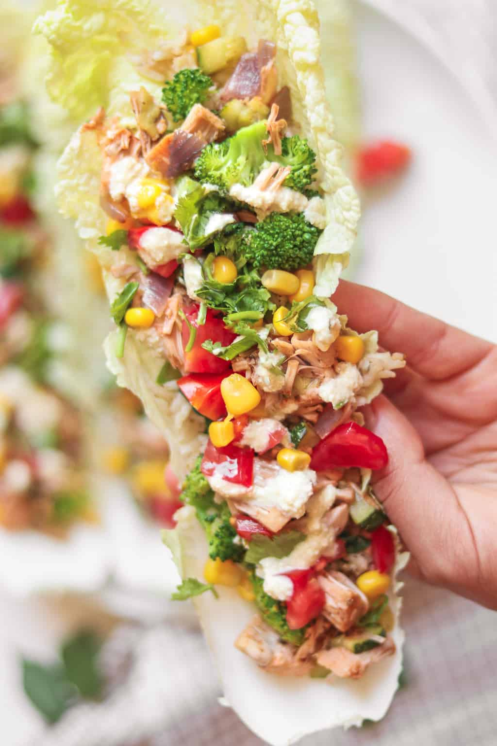 A vegan lettuce wrap filled with jackfruit, sweetcorn, brown rice and a cashew dressing