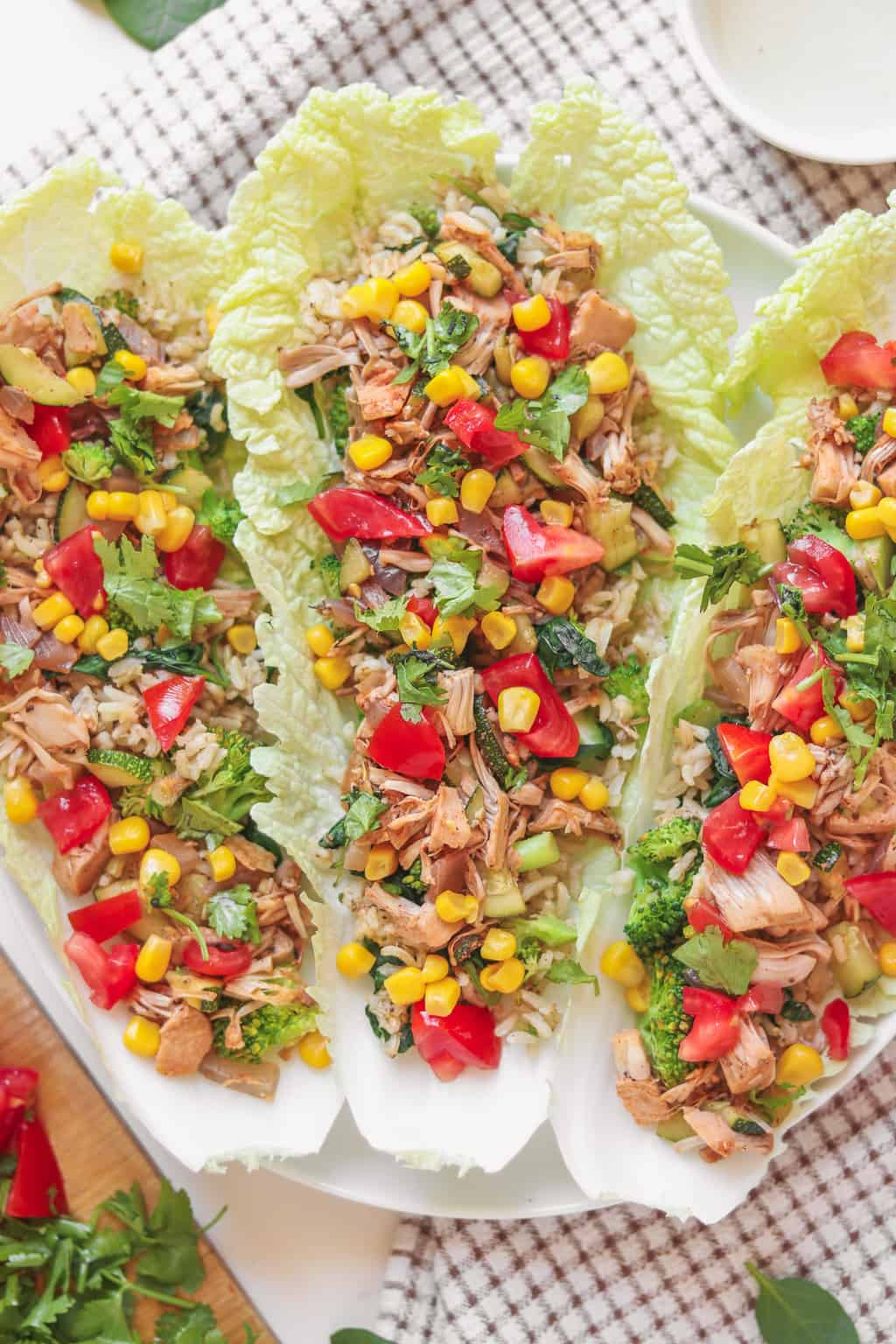 Vegan lettuce wraps with brown rice, jackfruit, sweetcorn and tomatoes