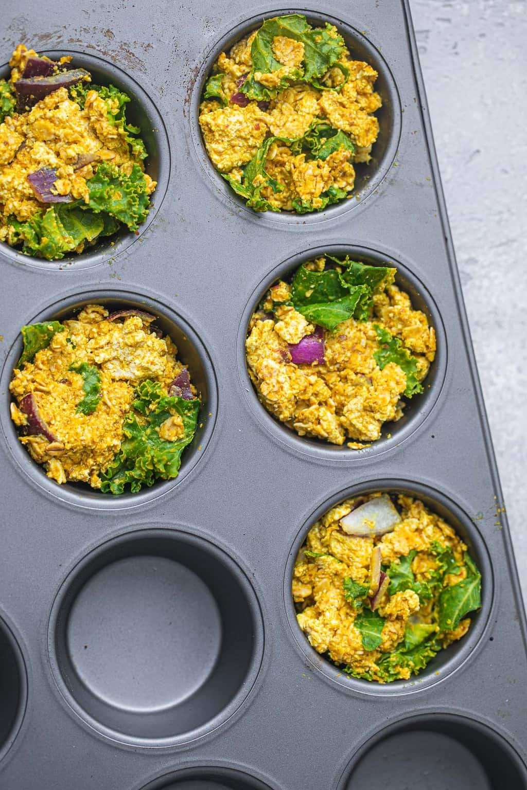 Muffin tray with vegan breakfast muffin batter