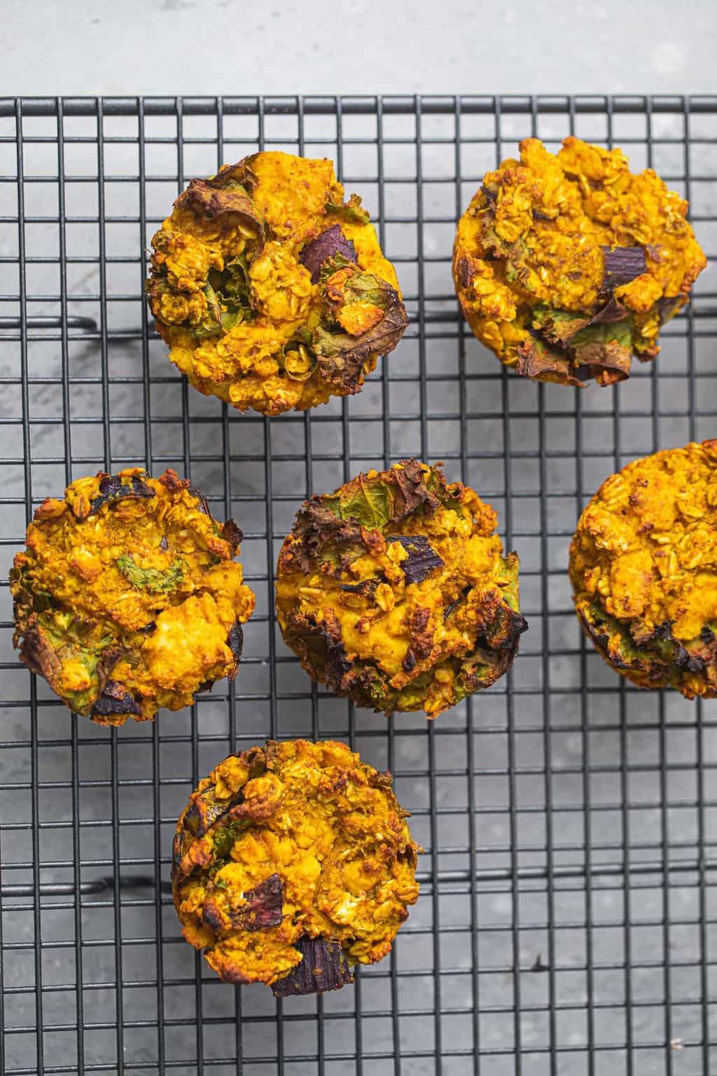 Vegan 'egg' muffins sitting on a cooling rack