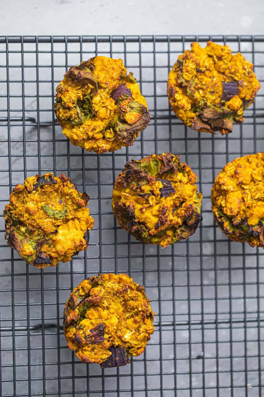Vegan muffins made from tofu, oats and chickpea flour on a cooling rack