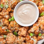 Vegan roasted cauliflower with a mild peanut yoghurt sauce