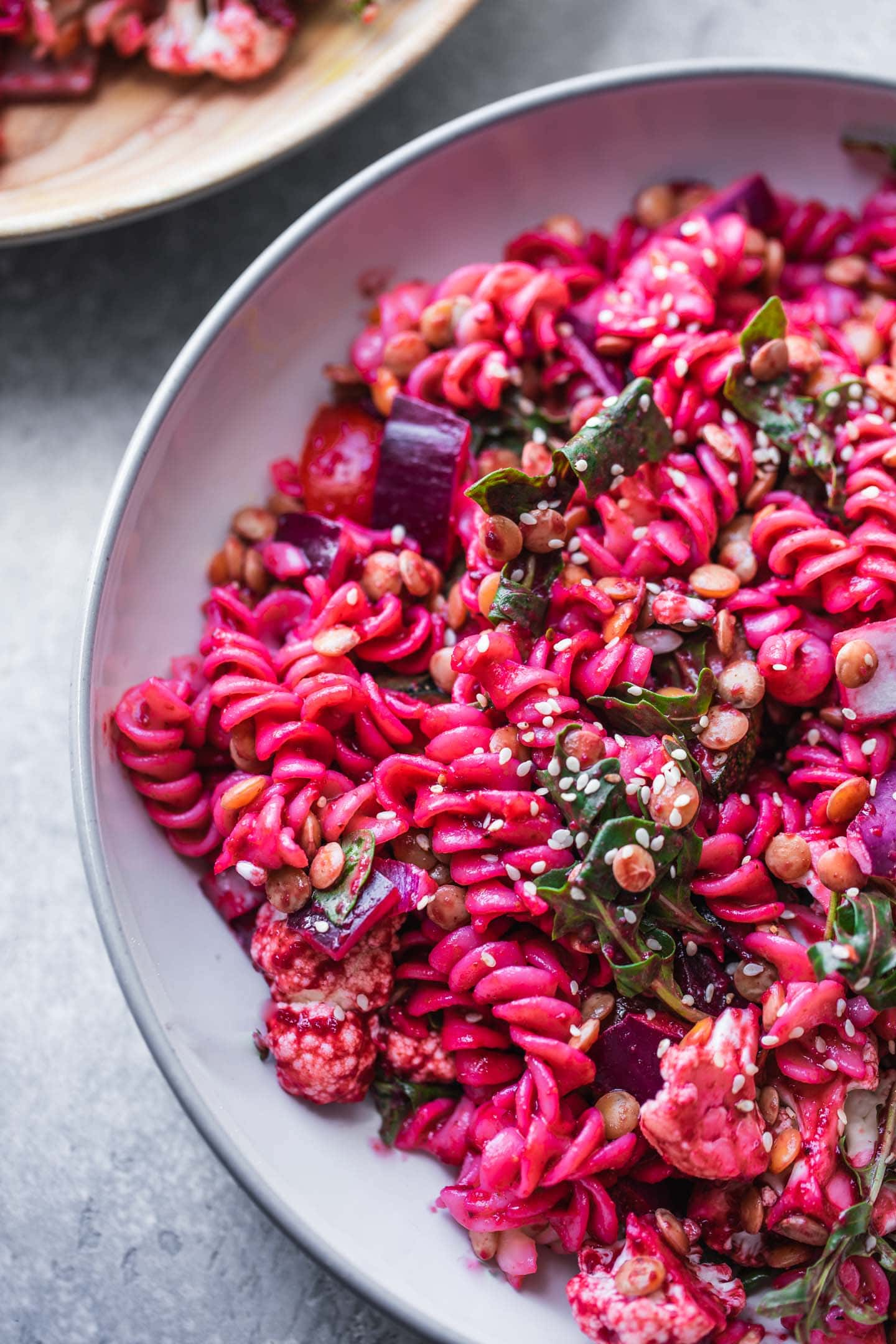 Vegan pasta salad with beetroot green lentils and vegetables
