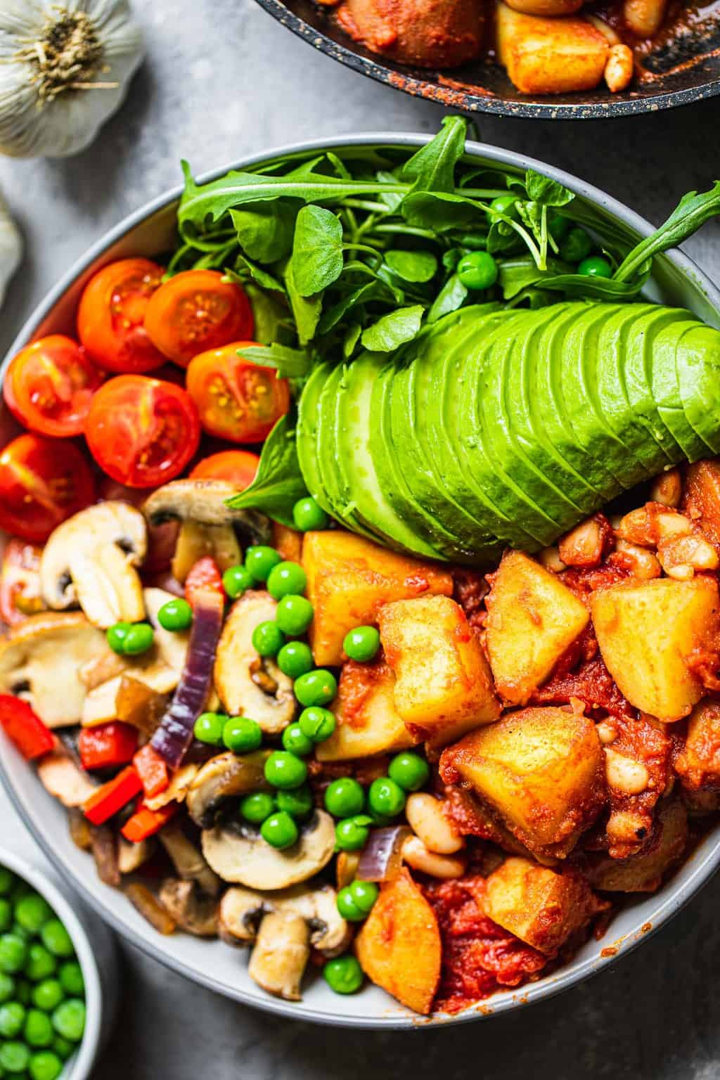 Bowl with potatoes, avocado and mushrooms
