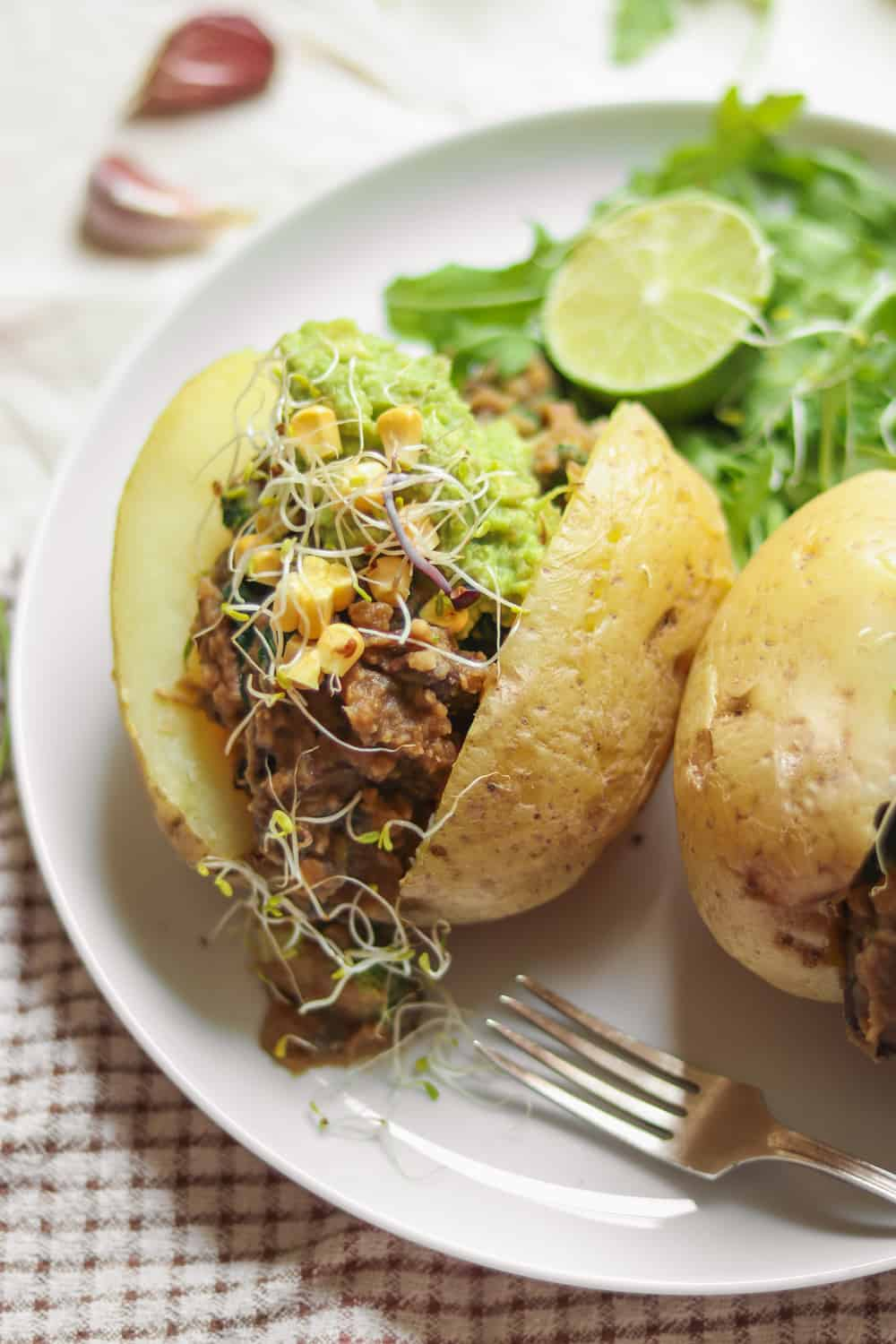 Vegan lunch baked potatoes with lentils, avocado and sweetcorn