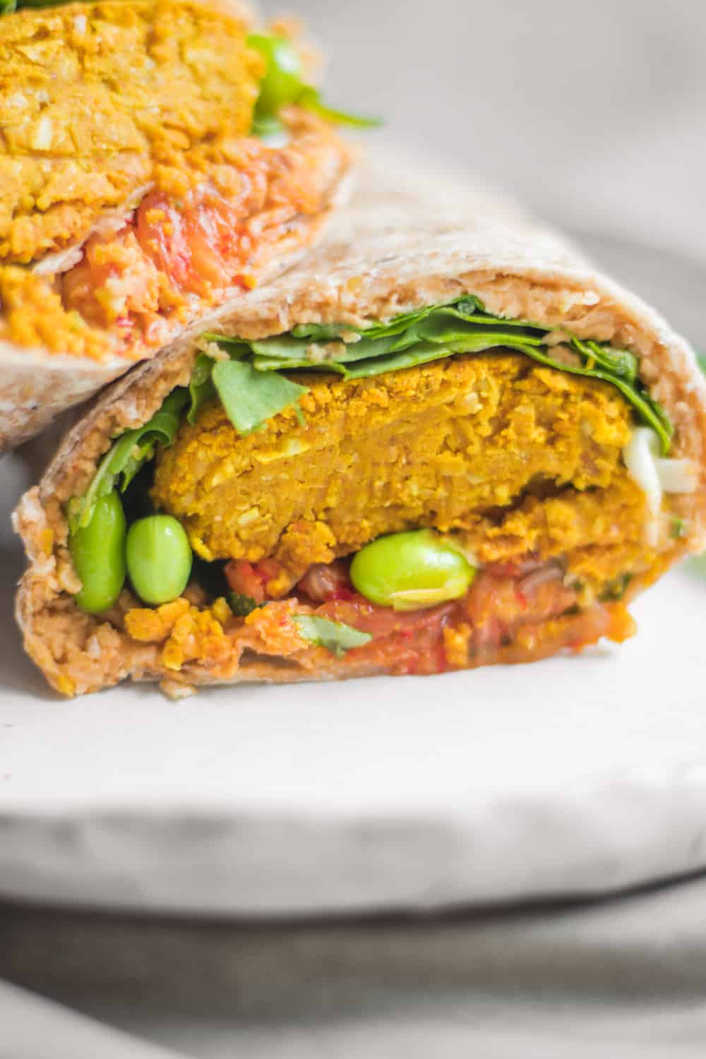 Healthy vegan baked falafel wraps with edamame and hummus