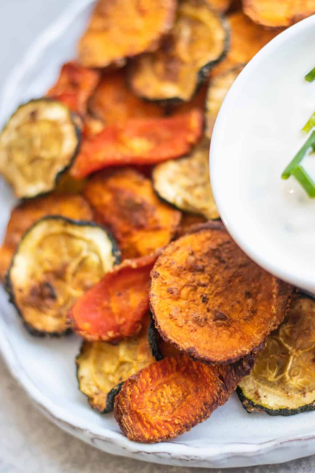 Healthy homemade veggie chips with vegan yoghurt dip