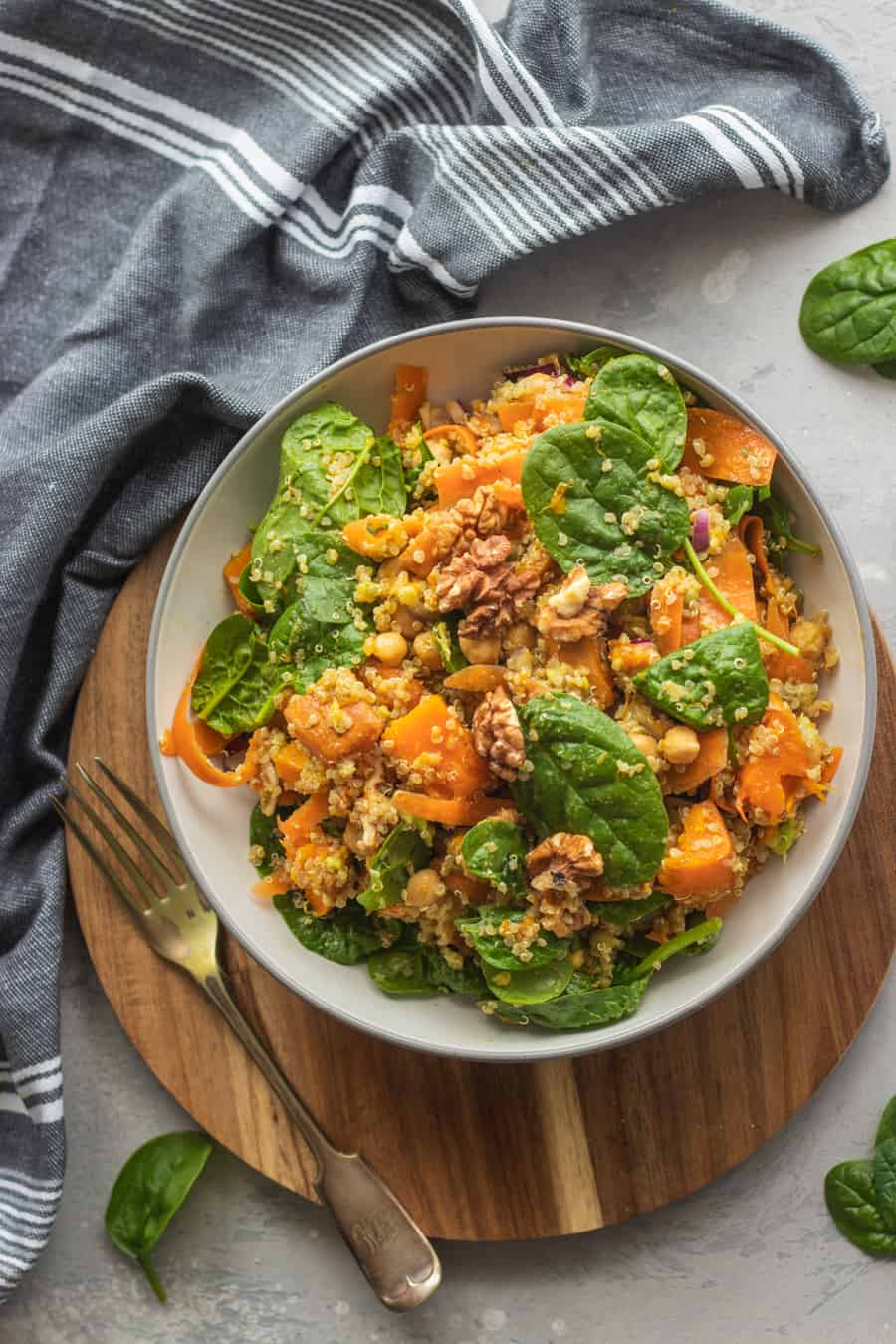 Vegan chickpea quinoa salad with pumpkin and spinach