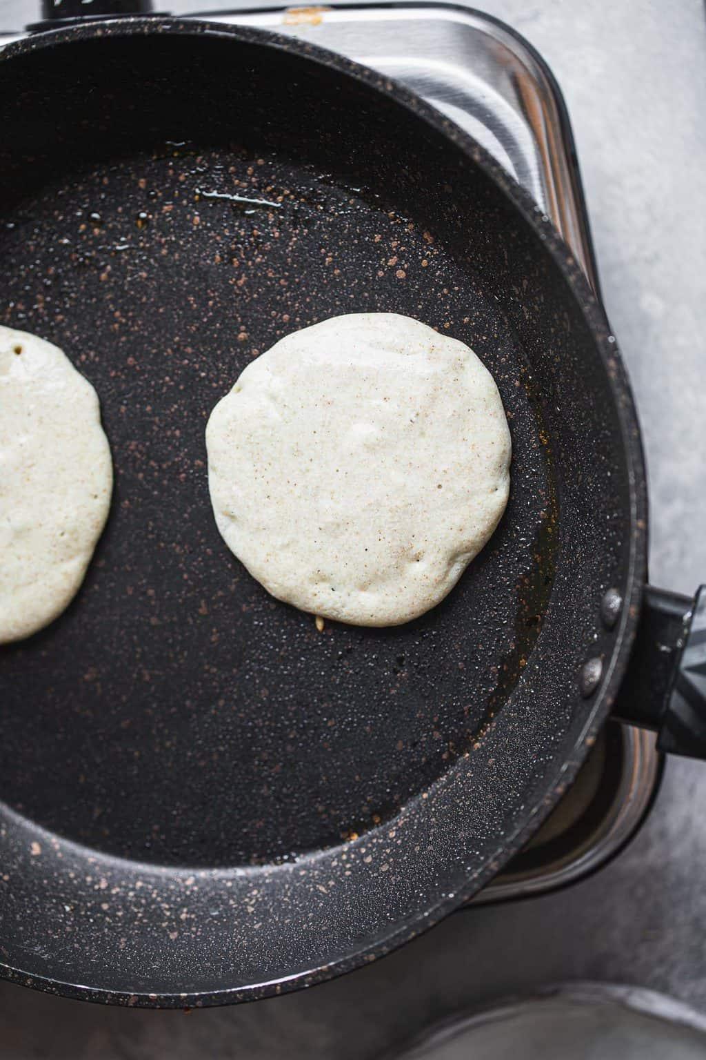 Buckwheat pancakes in a frying pan