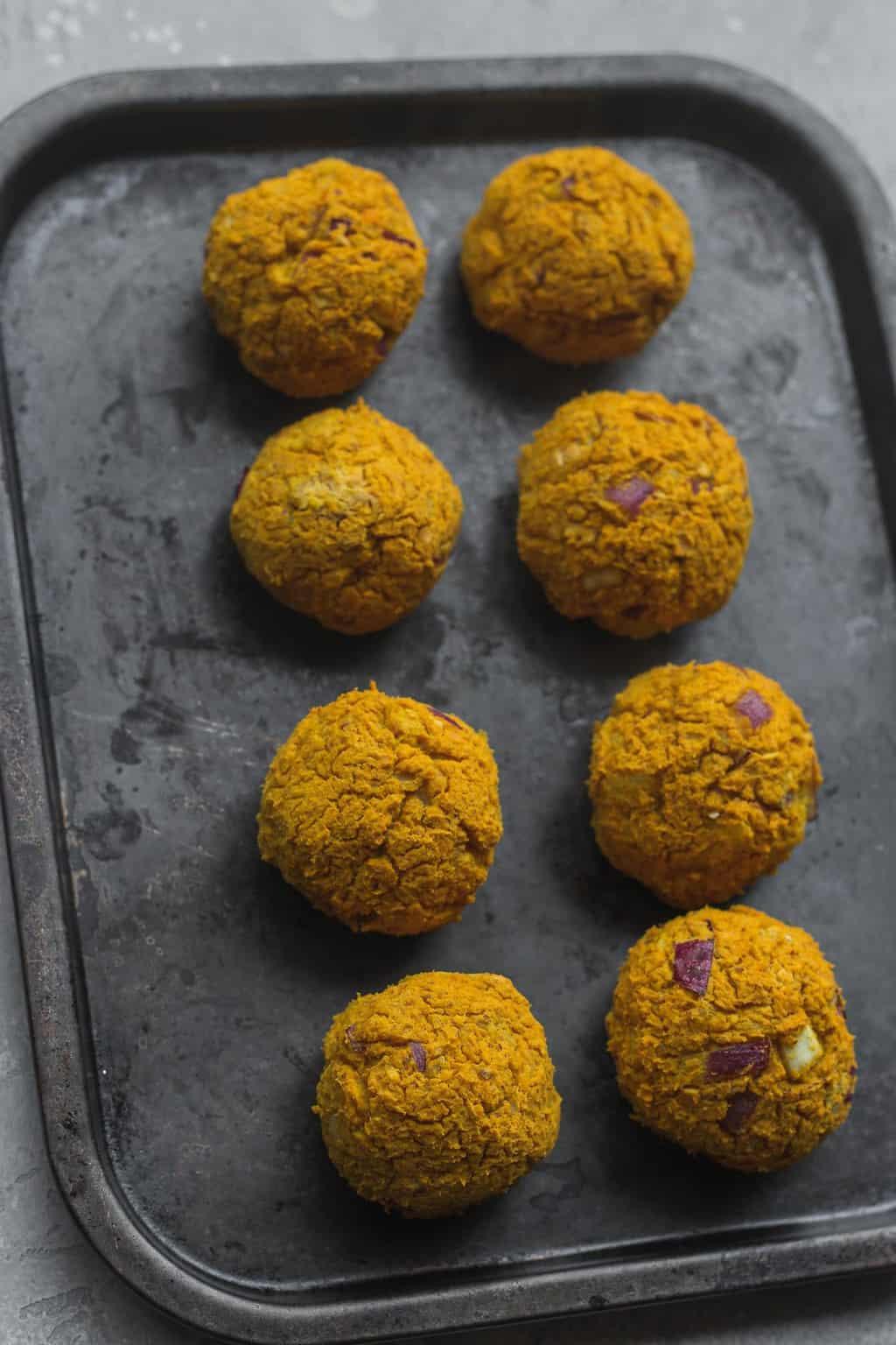 Vegan lentil meatballs on a baking sheet