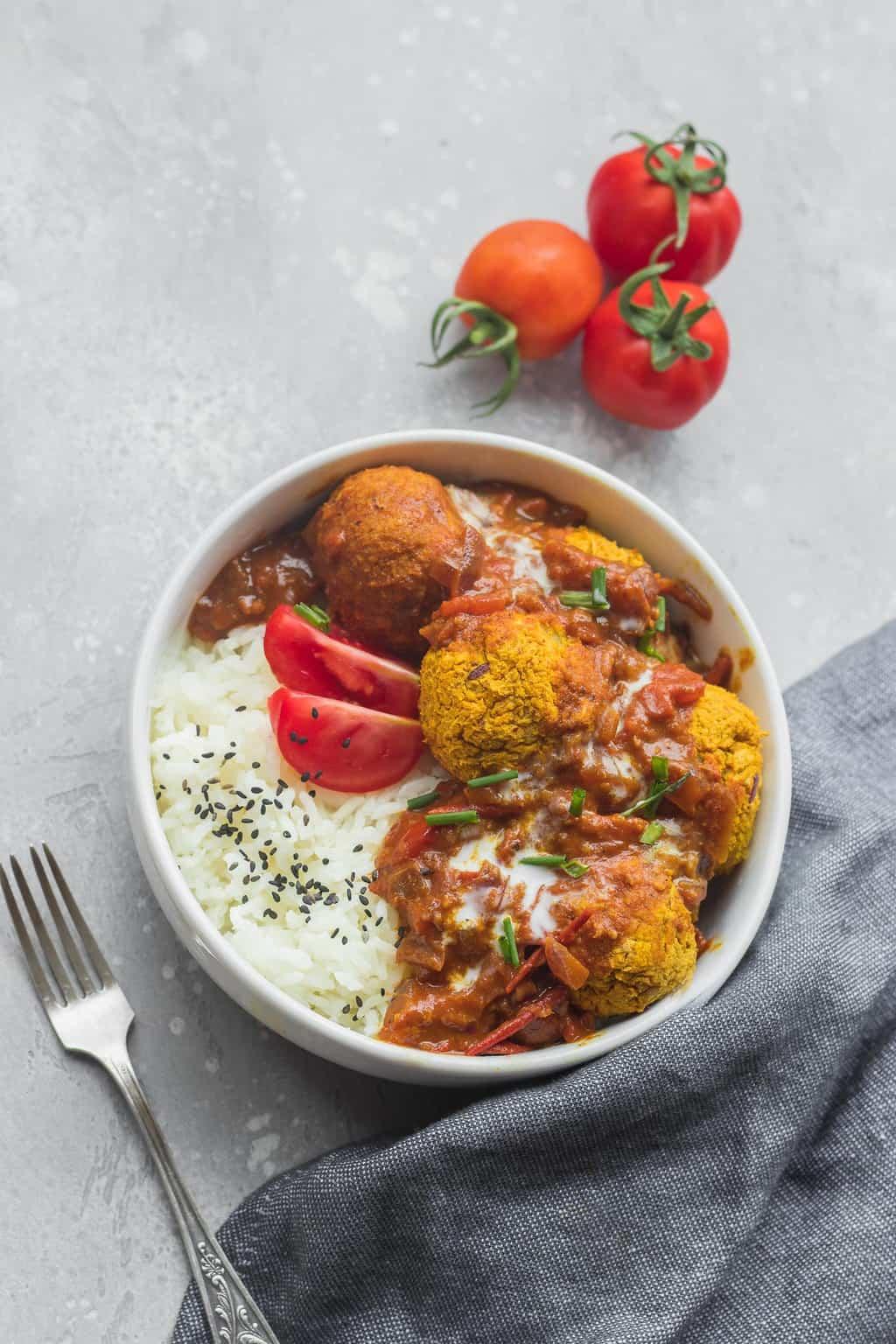 Vegan lentil meatballs in tomato curry sauce