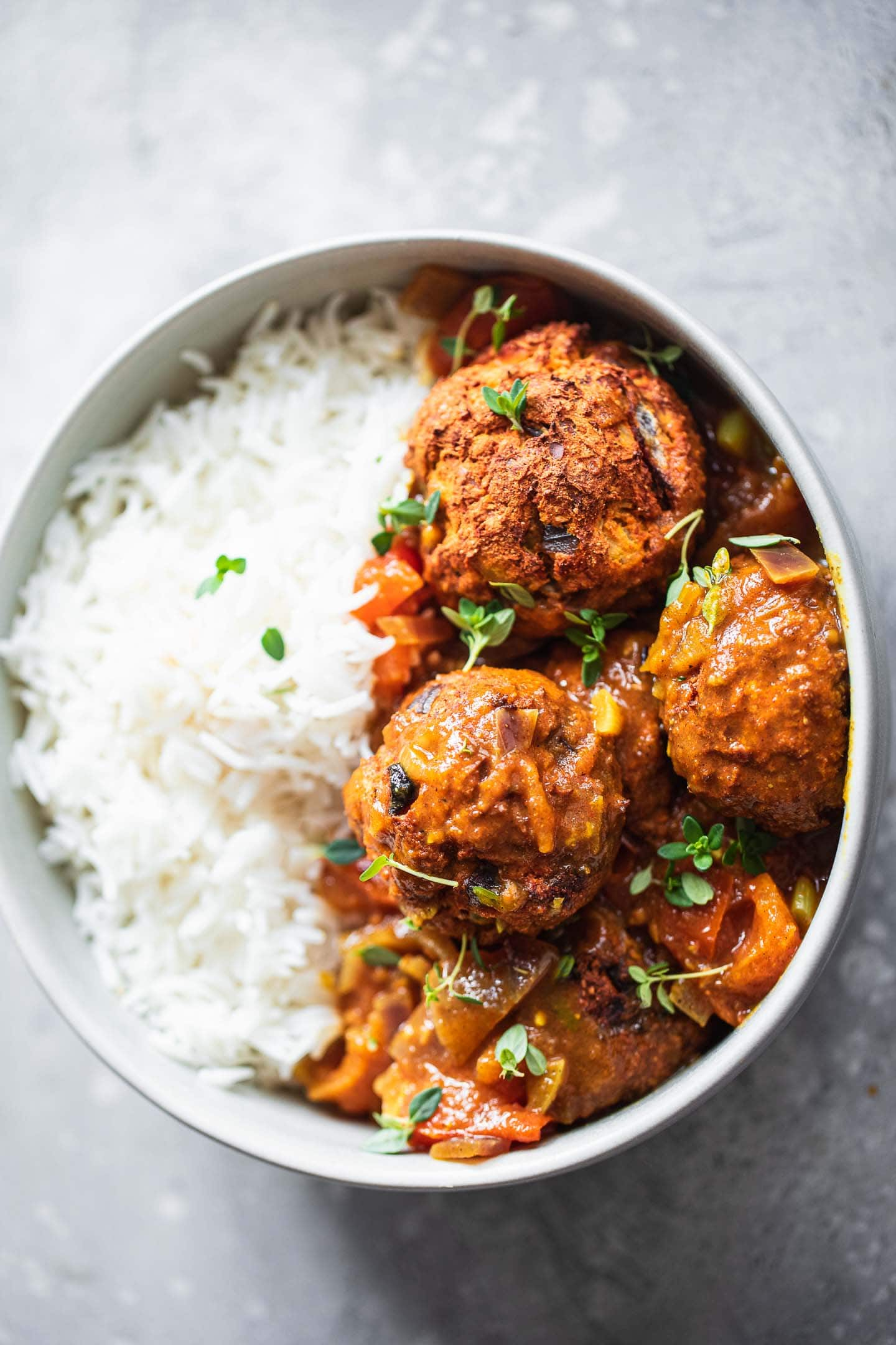 Vegan lentil meatballs with curry sauce and rice