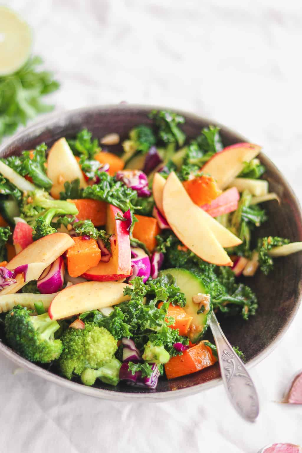 Closeup of vegan salad with butternut squash, kale and apple