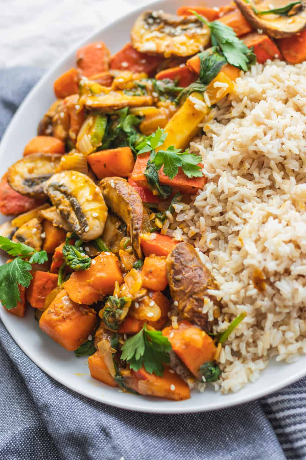 Vegan pumpkin and vegetable stir-fry with brown rice