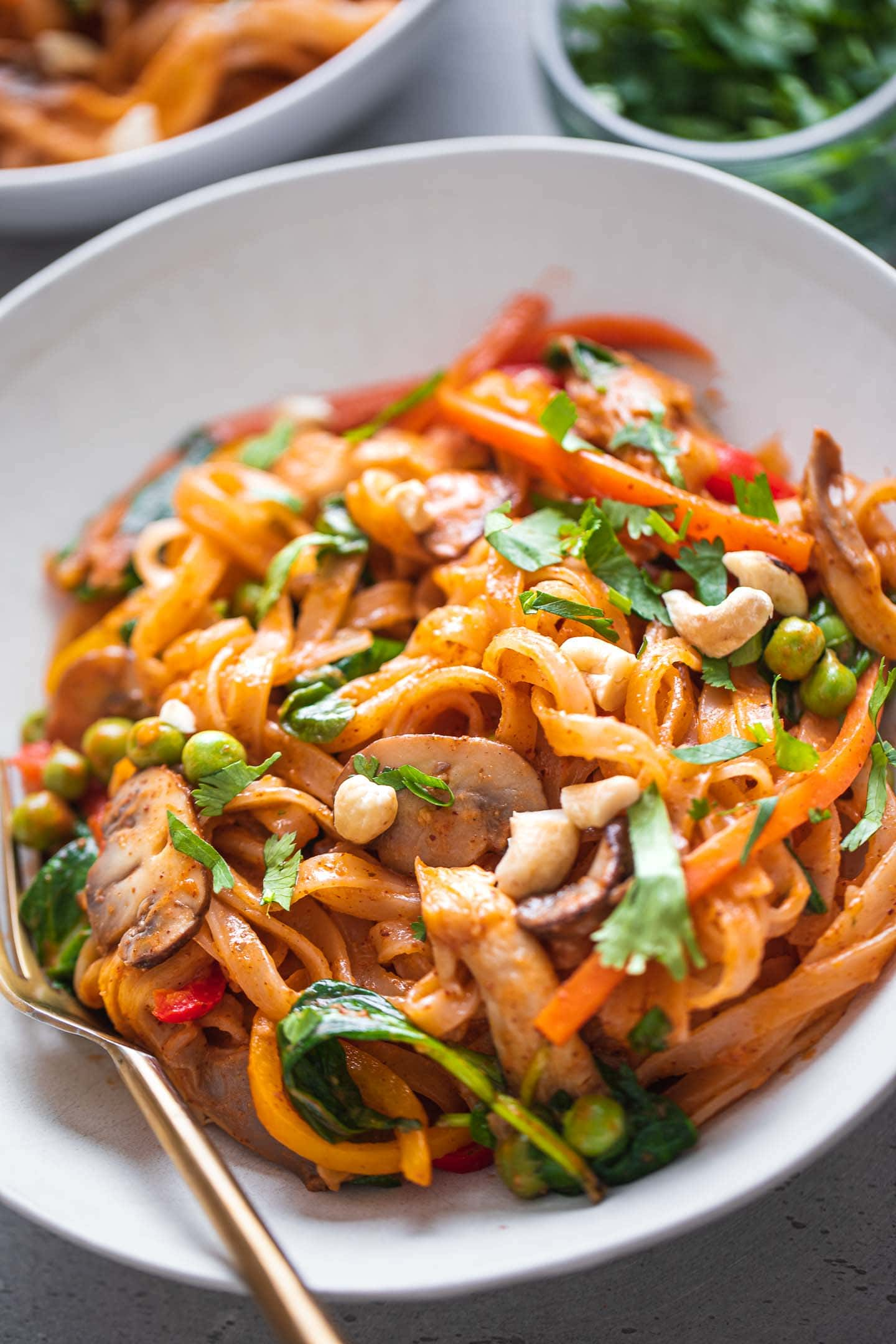 Rice noodle stir-fry with vegetables and peas