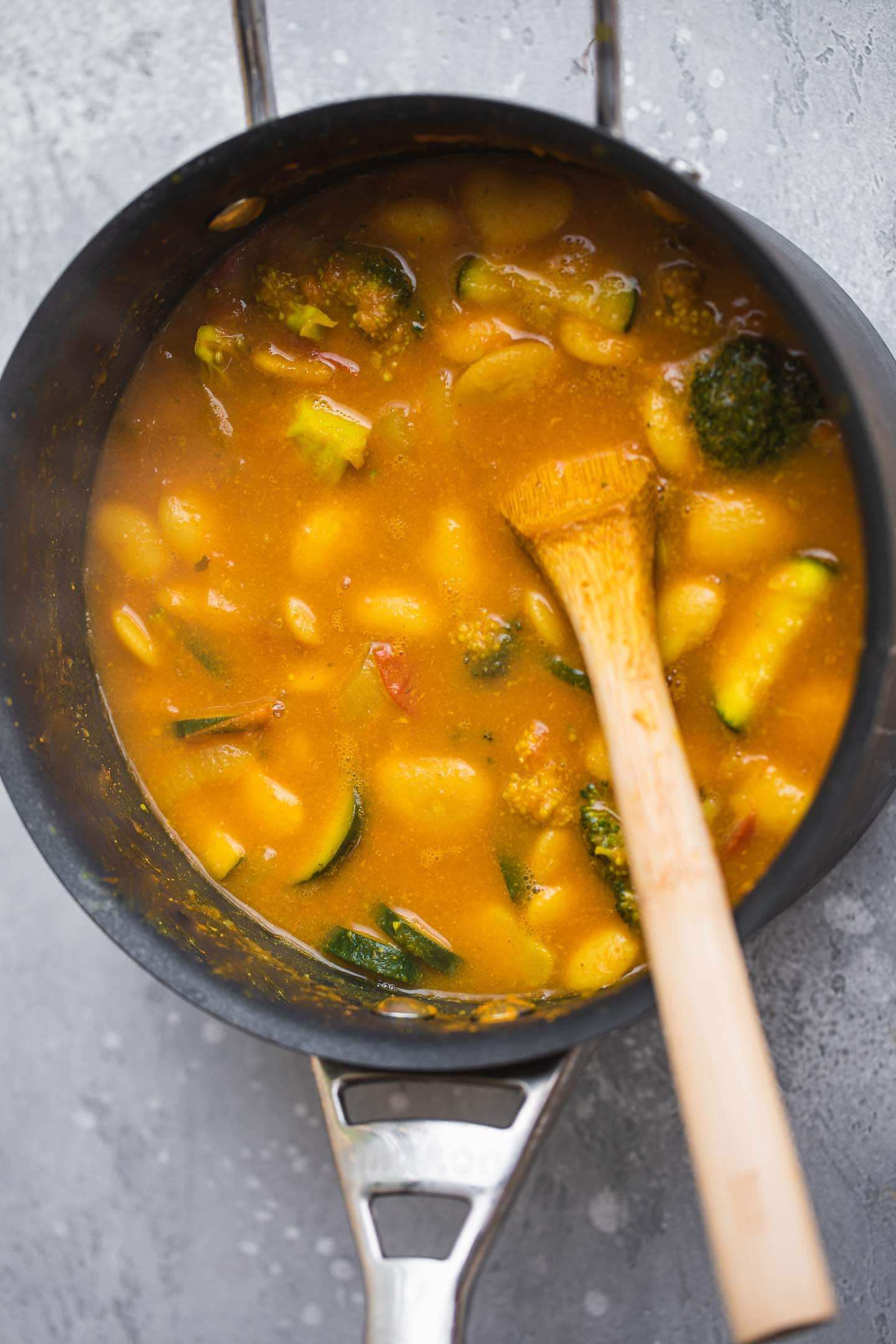 Stew with butter beans in a saucepan