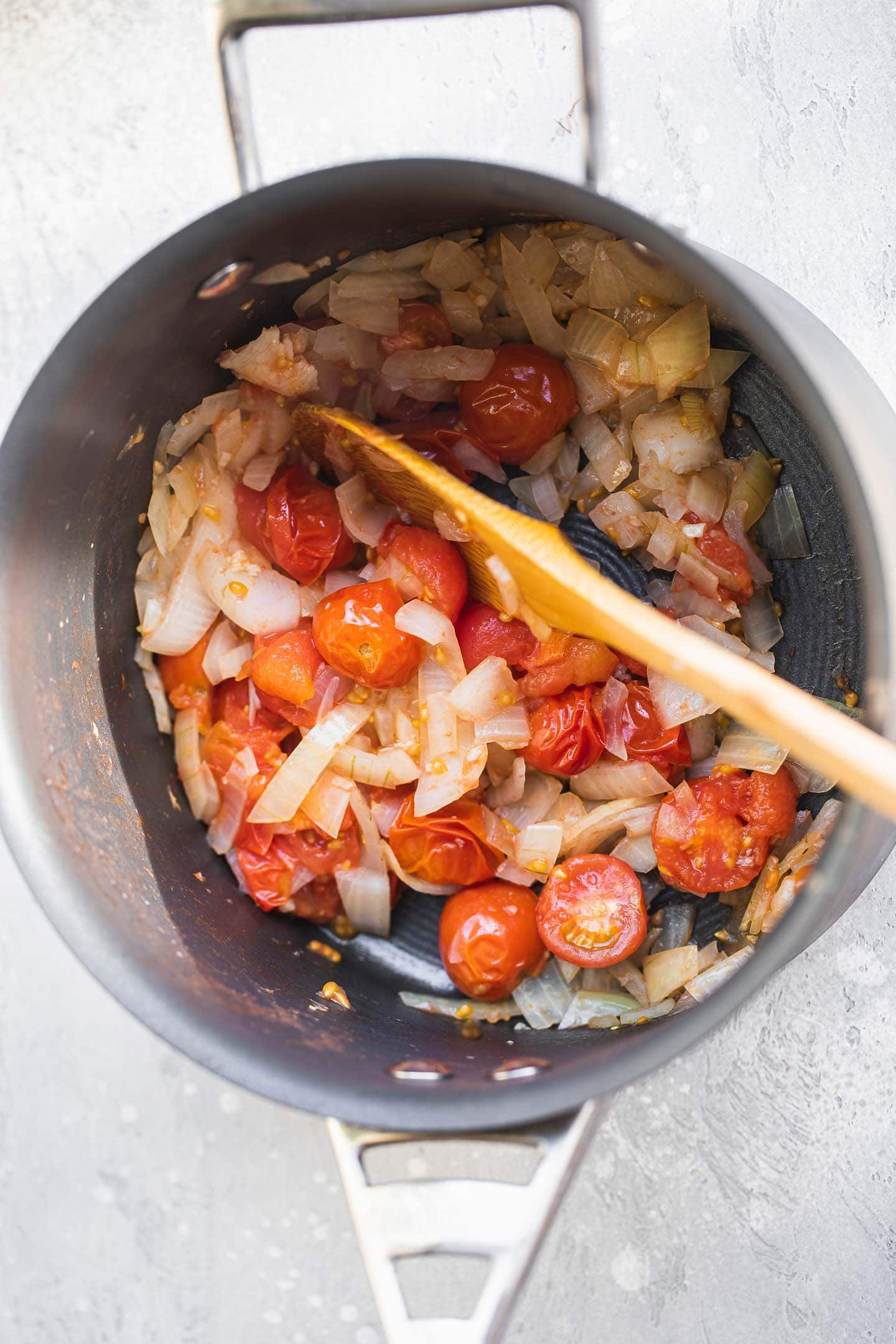 Tomatoes and onions in a saucepan