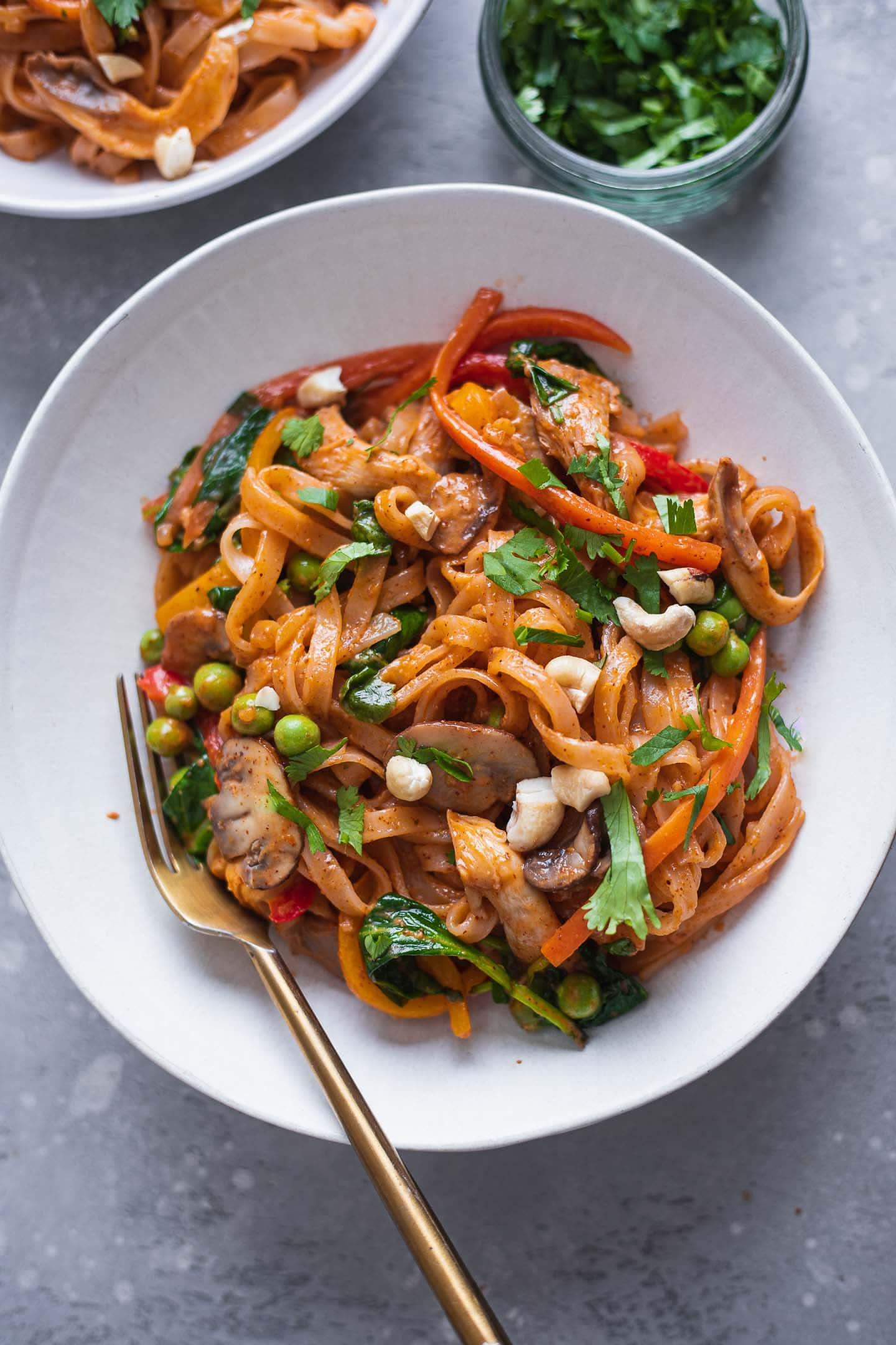 Two bowls of vegetable noodle stir-fry