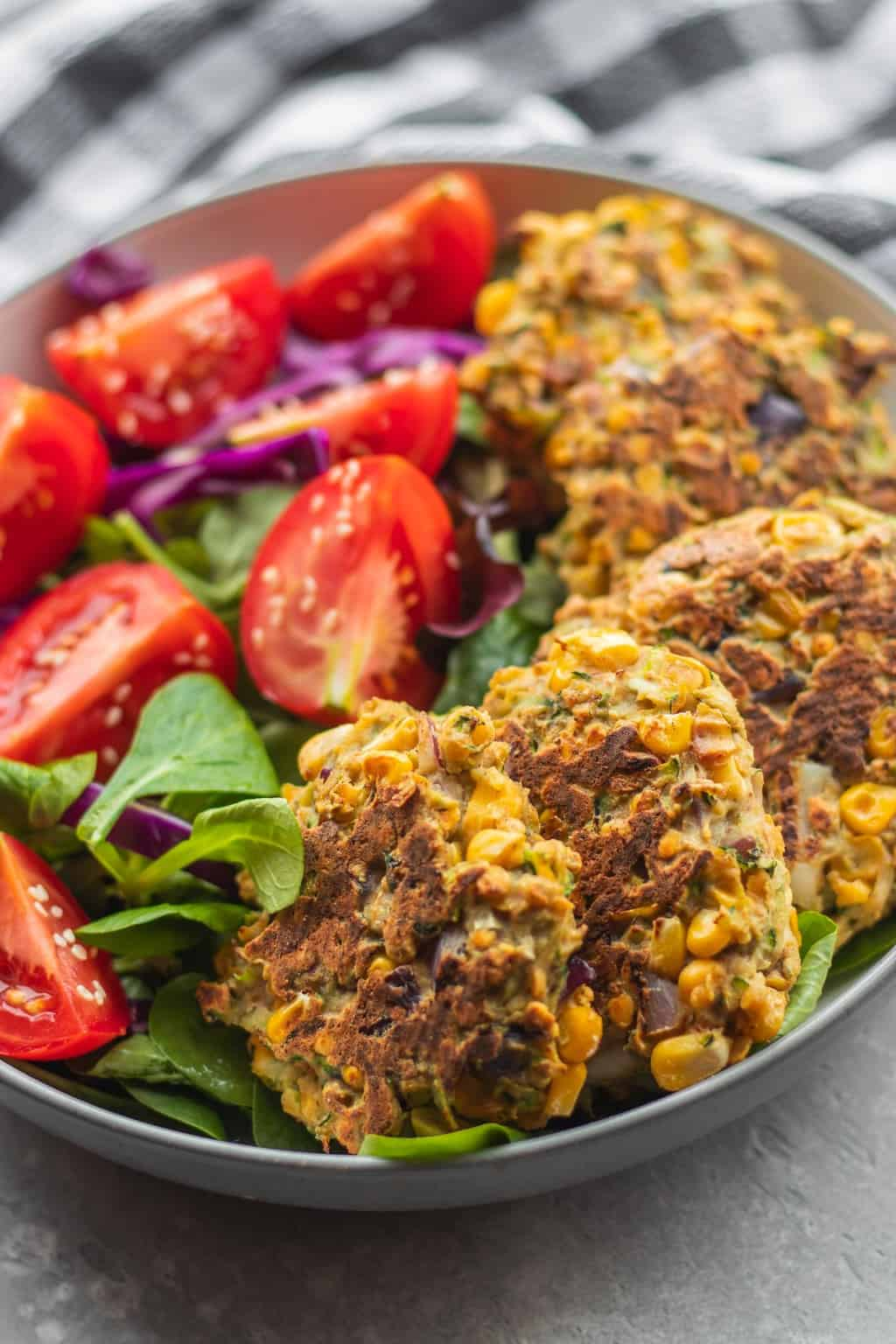 Vegan red lentil zucchini fritters with salad