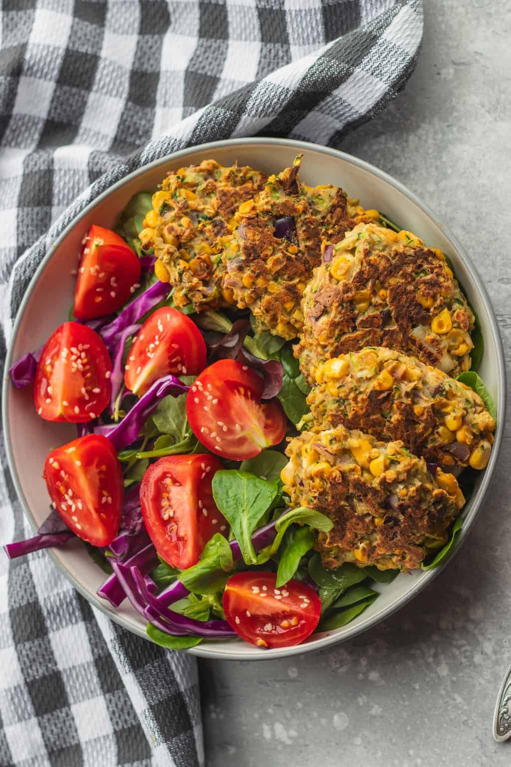 Healthy vegan zucchini fritters with salad