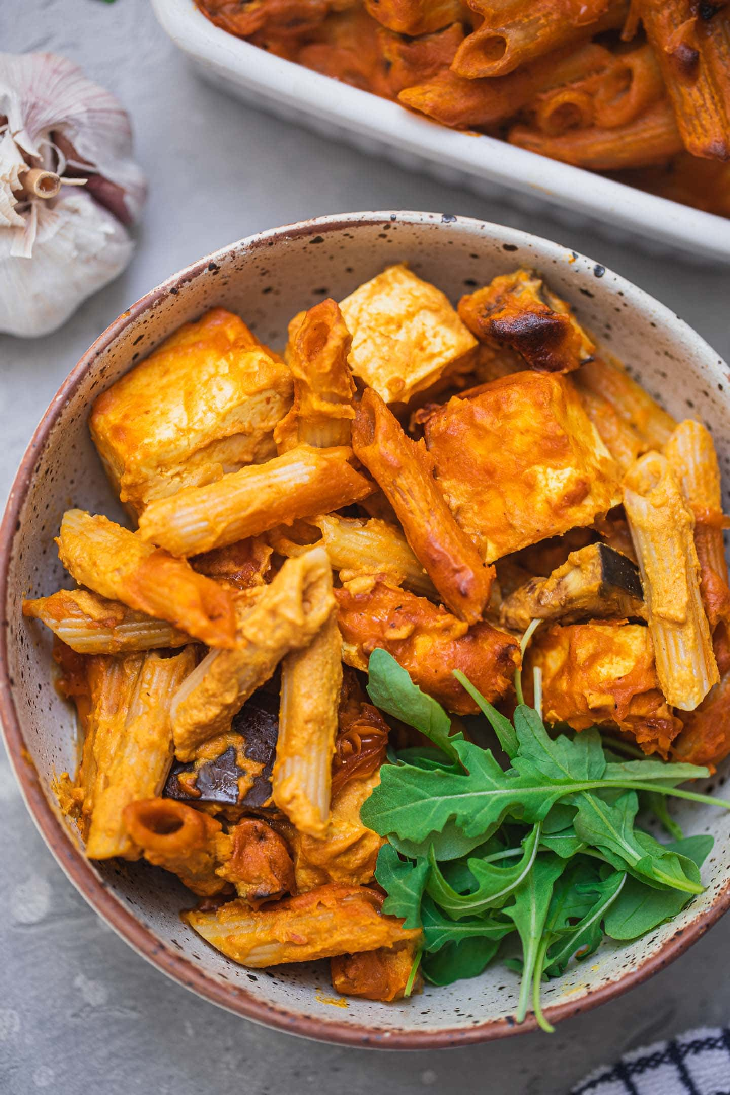 Pasta bake with tofu and aubergine in a bowl