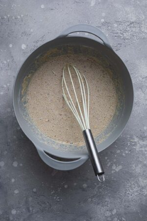Buckwheat crepe batter in a mixing bowl