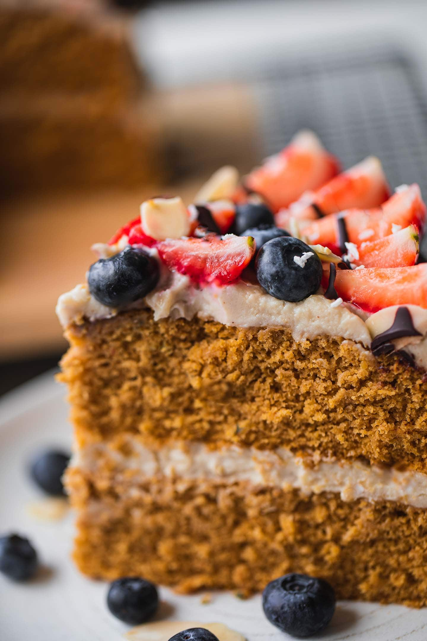 Closeup of a slice of cake with berries