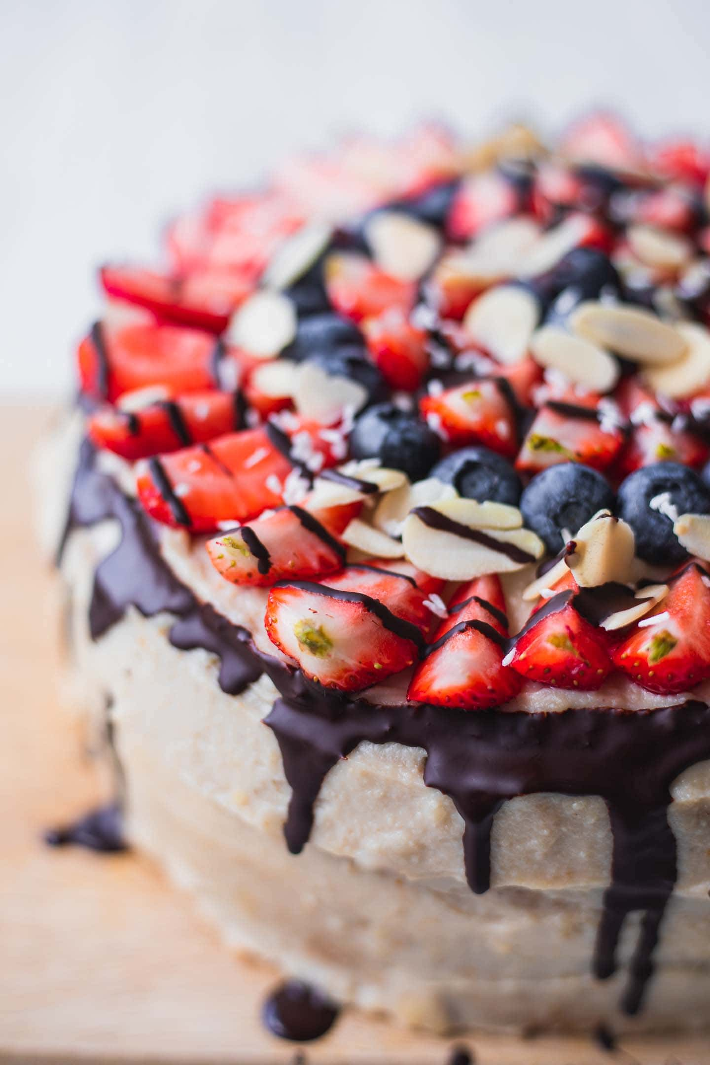 Closeup of vegan cake with berries and chocoalate