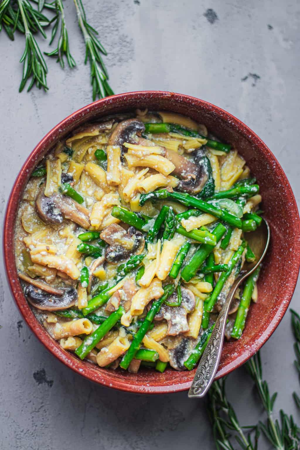 Bowl of pasta with asparagus and mushrooms