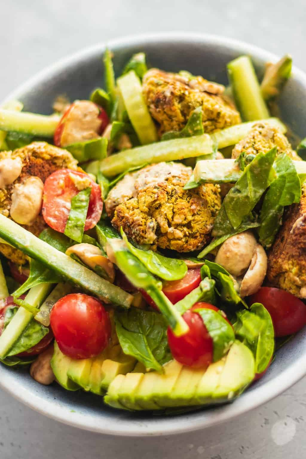Vegan falafel salad with lemon tahini dressing and avocado