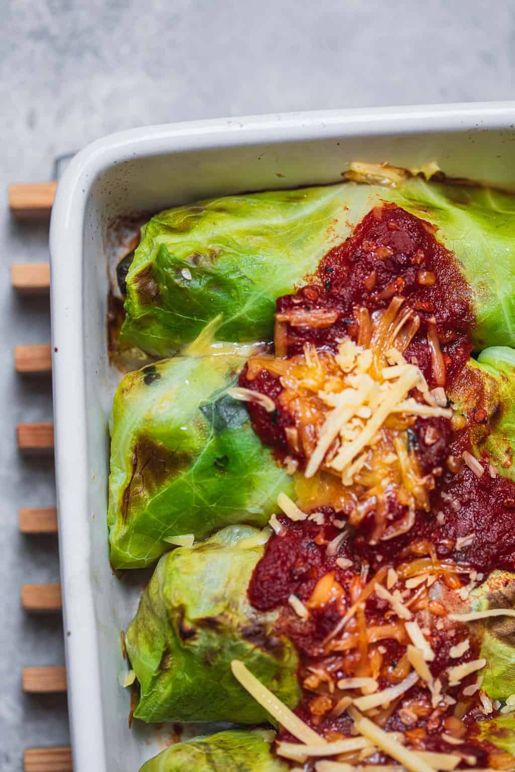Closeup of stuffed cabbage rolls in a baking dish