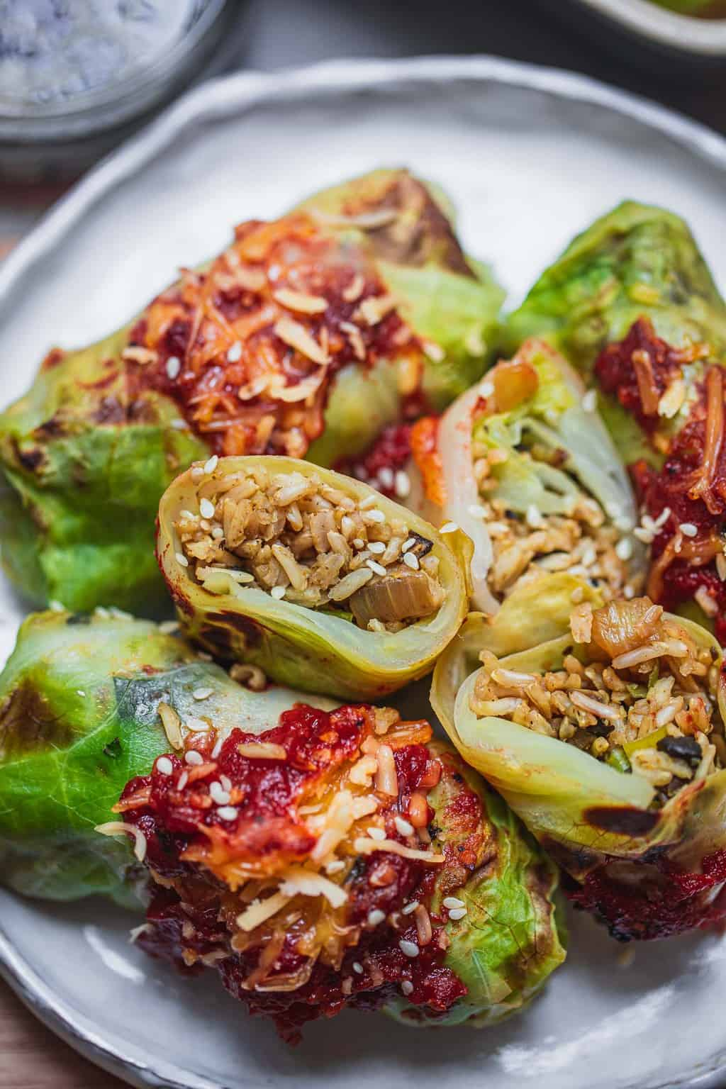 Plate with vegan cabbage rolls stuffed with rice and mushrooms