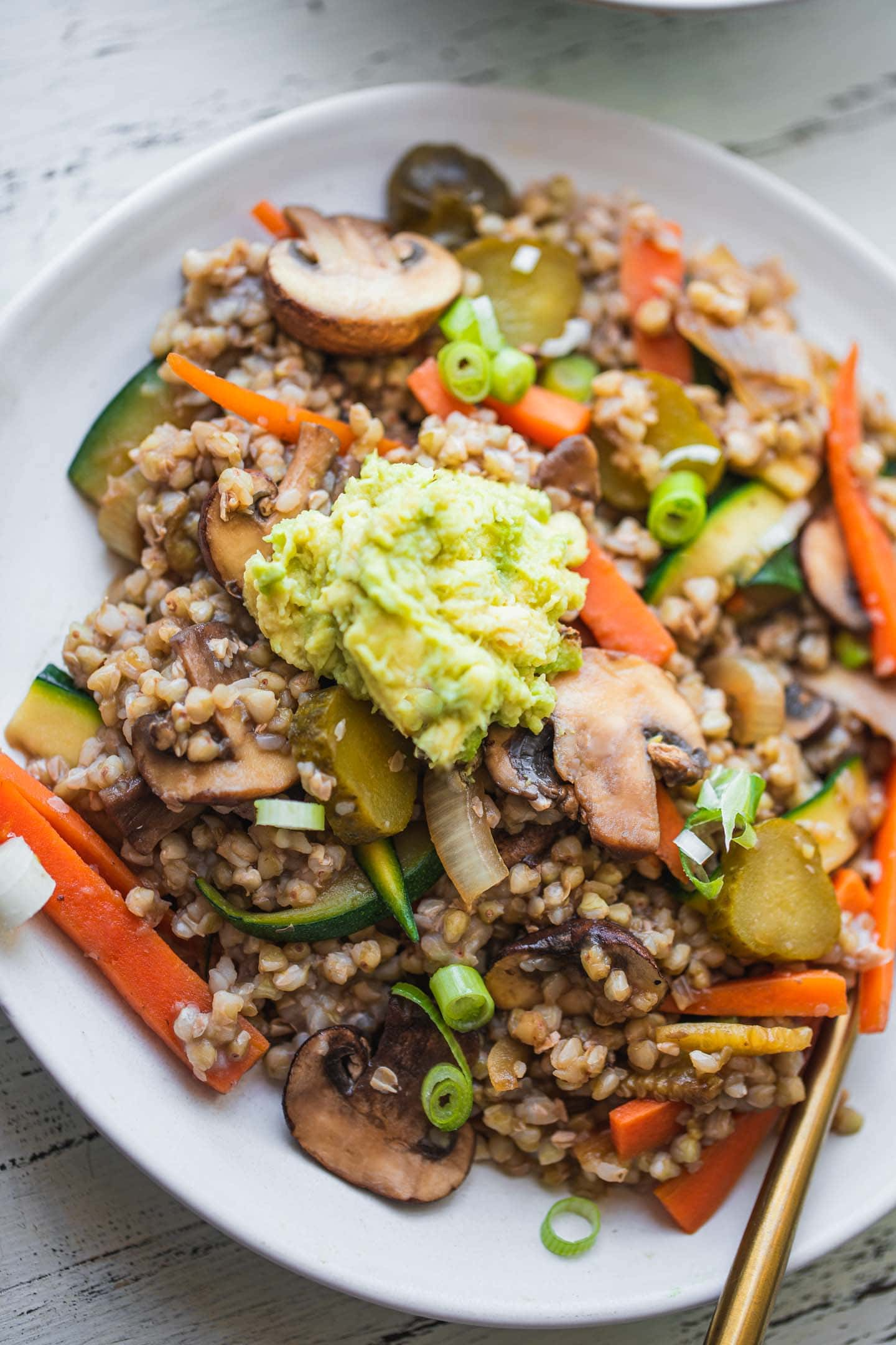 Buckwheat with vegetables and avocado sauce in a bowl