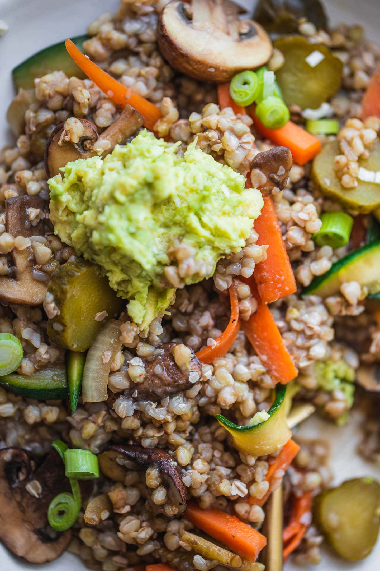 Closeup of buckwheat with vegetables and avocado