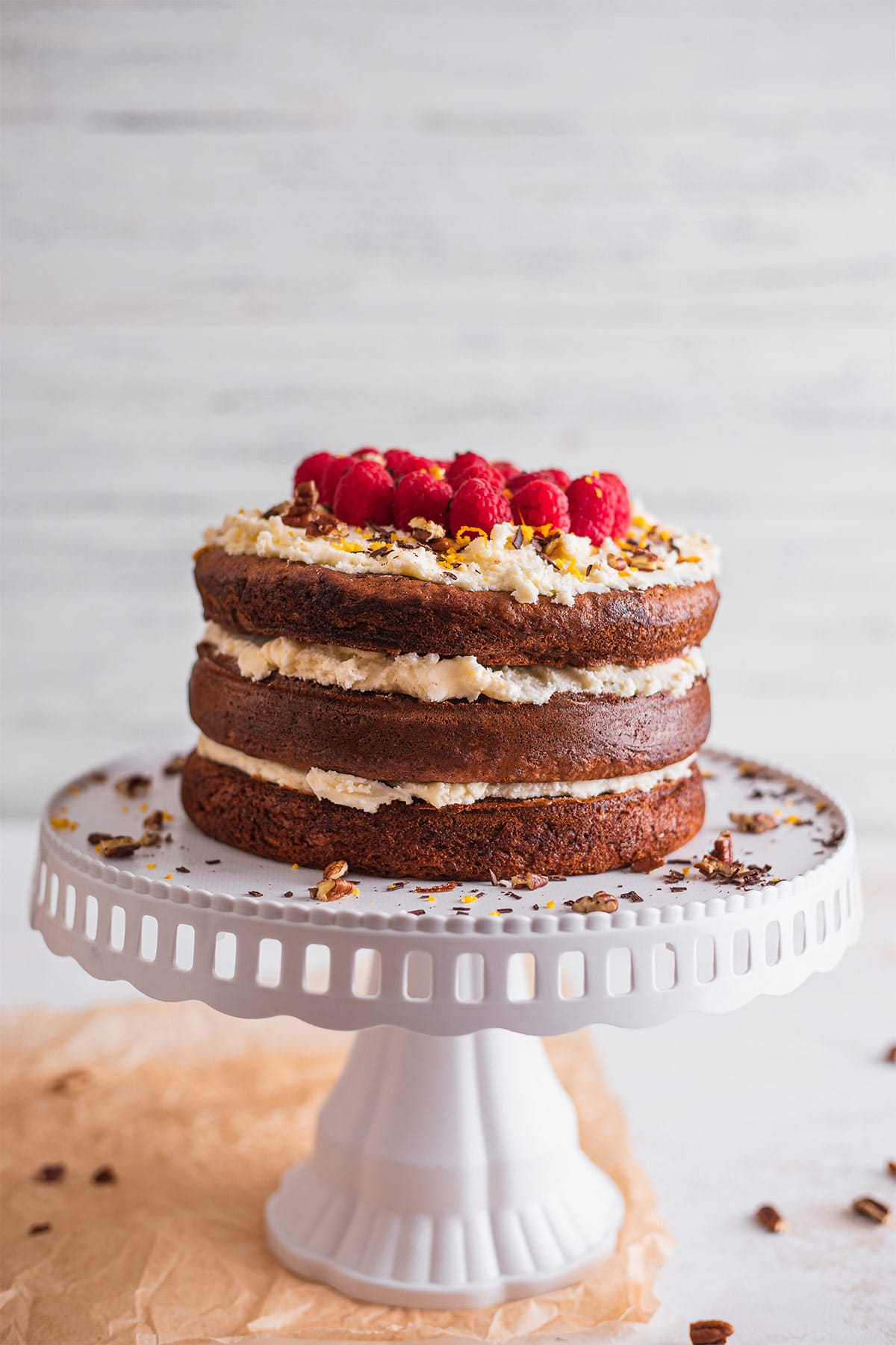 Vegan carrot cake with frosting on a cake stand