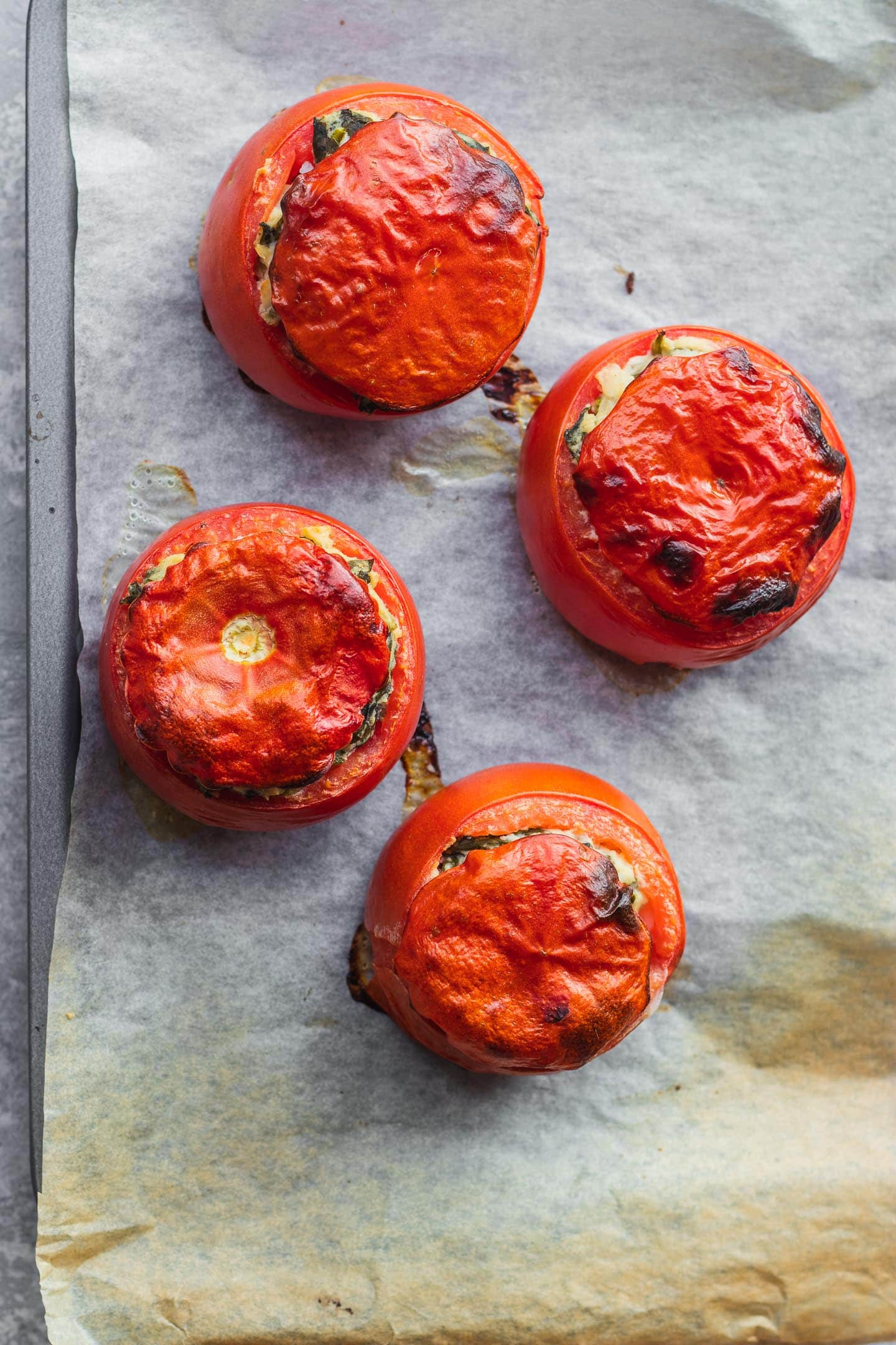 Vegan stuffed tomatoes with rice and creamed spinach