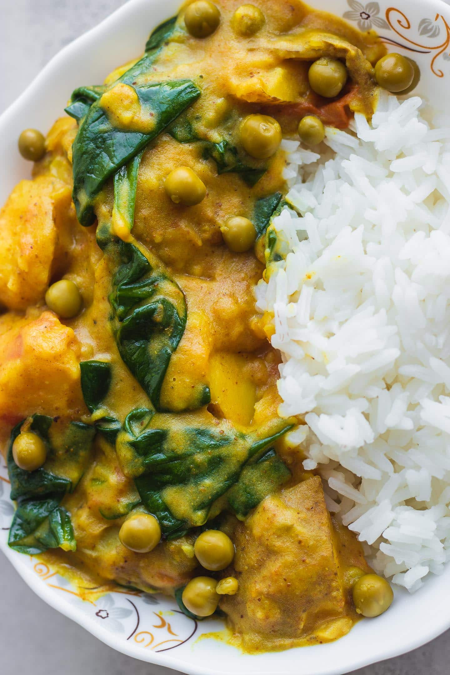 Closeup of vegan curry in a white bowl