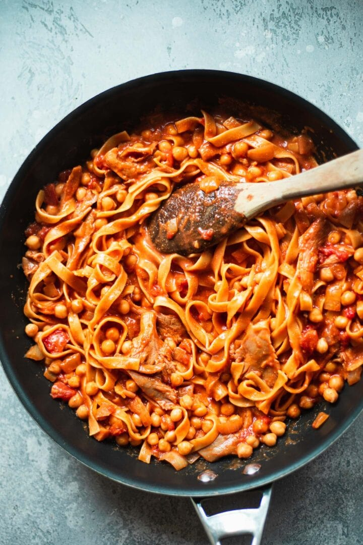 Tomato sauce pasta in a pan with chickpeas