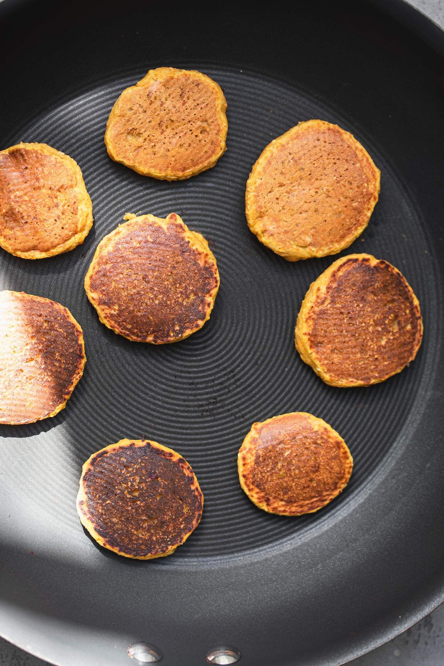 Mini vegan pancakes in a frying pan