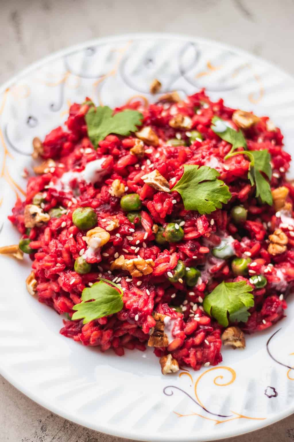 Beetroot risotto with walnuts and peas