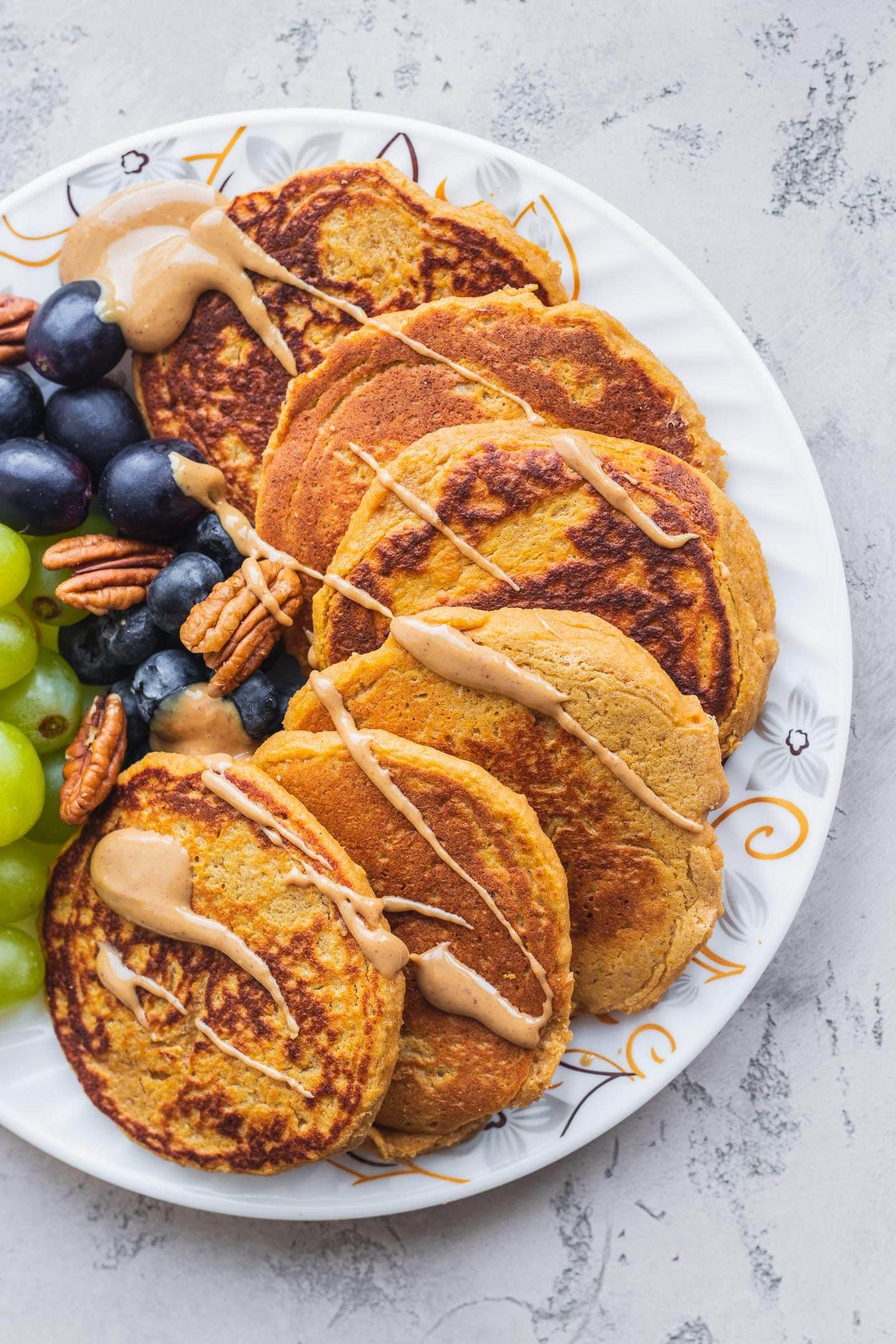 Pancakes on a white plate with peanut butter