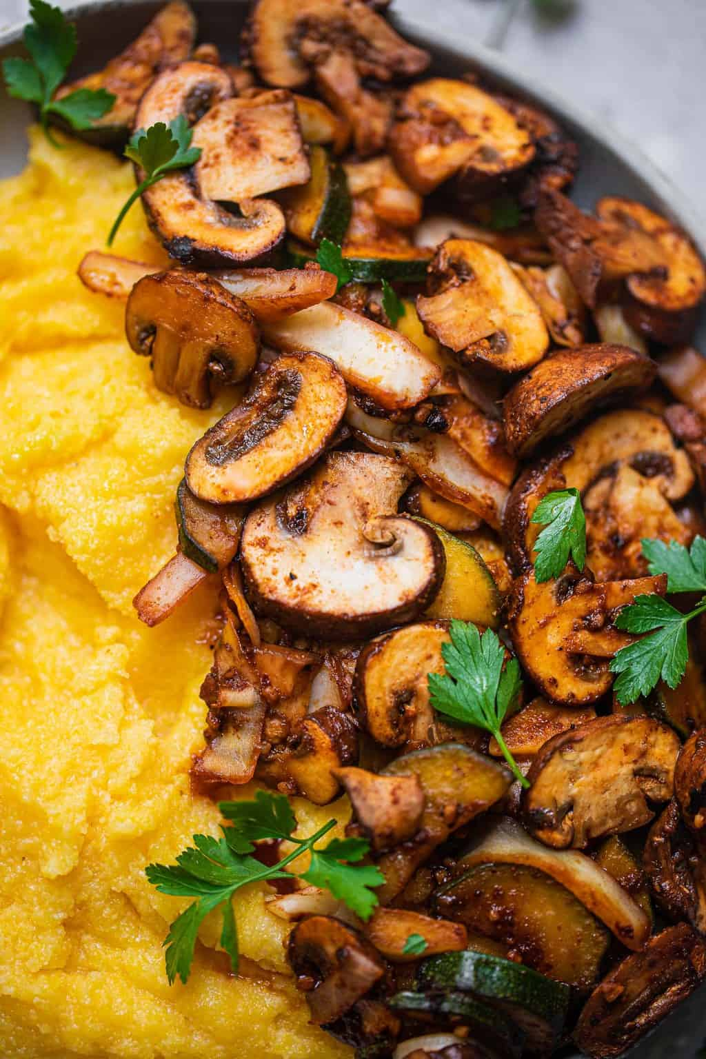Closeup of mushrooms over polenta