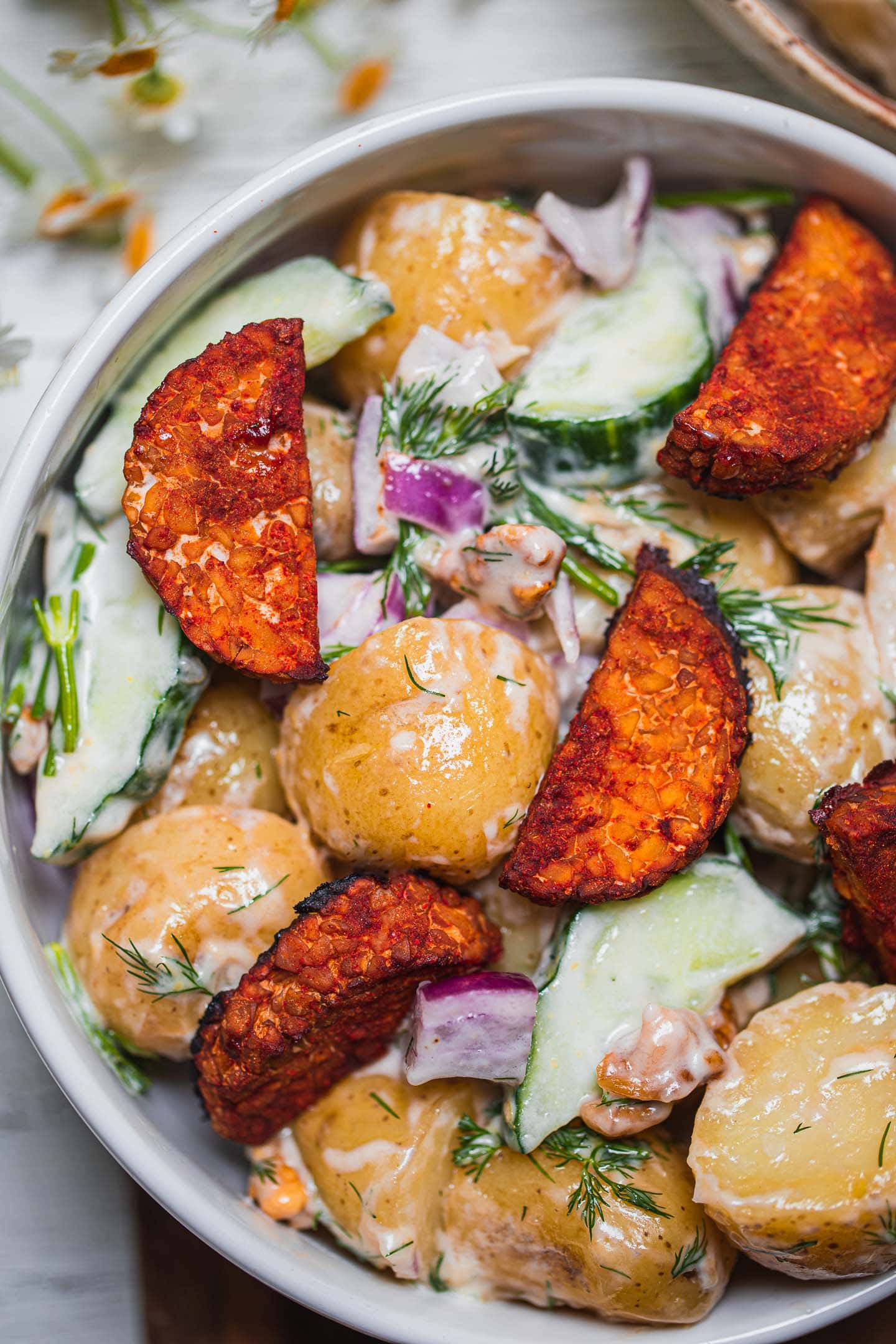 Closeup of a vegan potato salad with tempeh