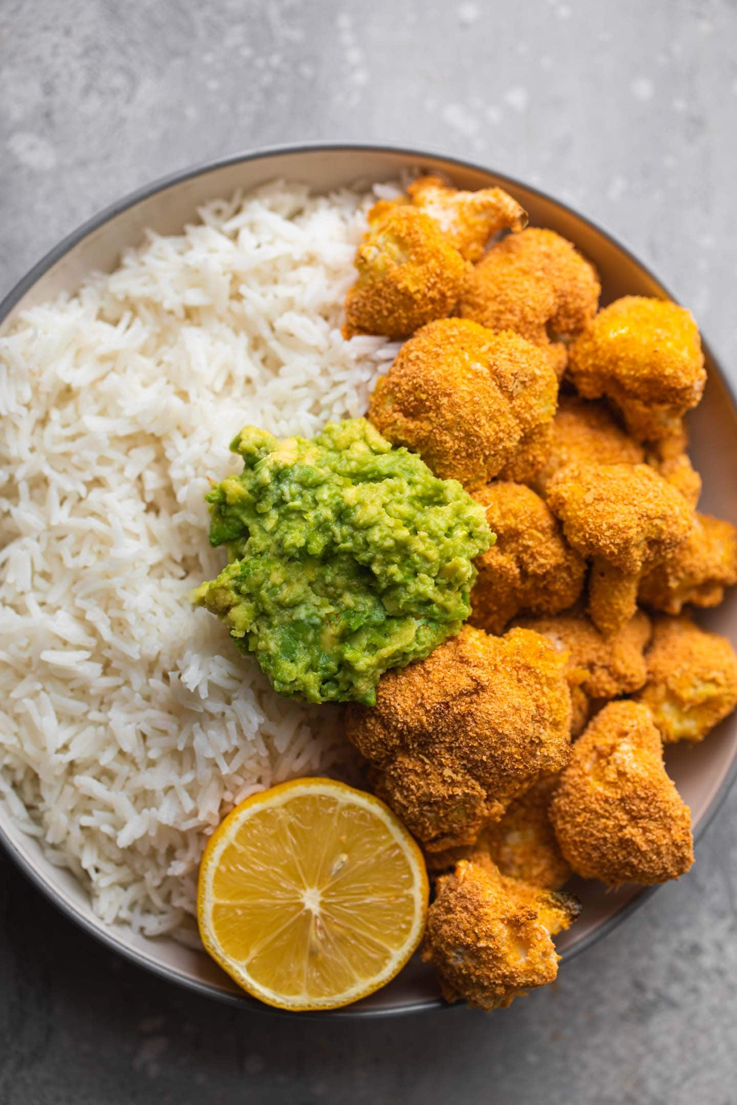 Bowl with breaded cauliflower, rice and avocado